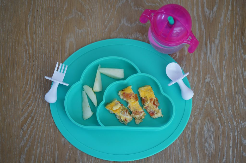 Introducing solids: my 8 month-old's lunch - omelette, pear and water.